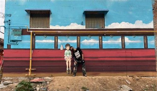 河南小伙画出30多面涂鸦墙 让昔日小村庄成了潮流打卡地